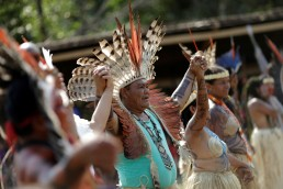 Indigenous people from the Shanenawa tribe dance during a festival in the indigenous village of Morada Nova near Feijo