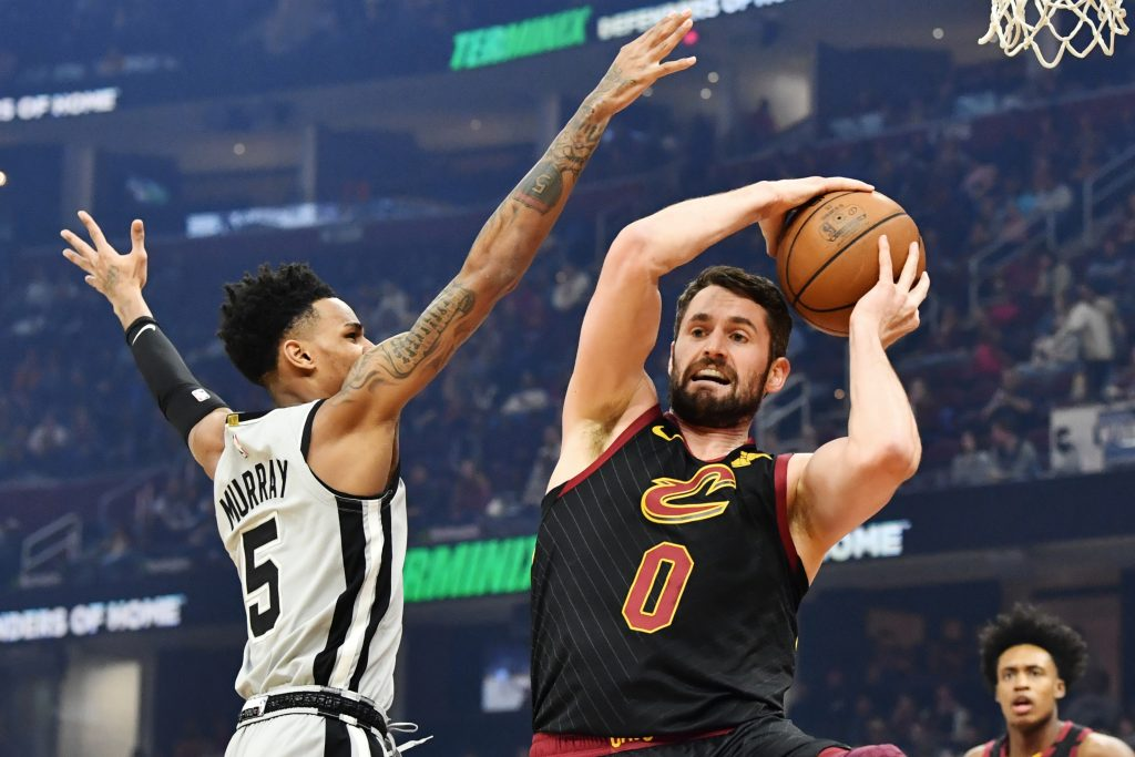 Mar 8, 2020; Cleveland, Ohio, USA; Cleveland Cavaliers forward Kevin Love (0) grabs a rebound from San Antonio Spurs guard Dejounte Murray (5) during the first half at Rocket Mortgage FieldHouse. Ken Blaze-USA TODAY Sports