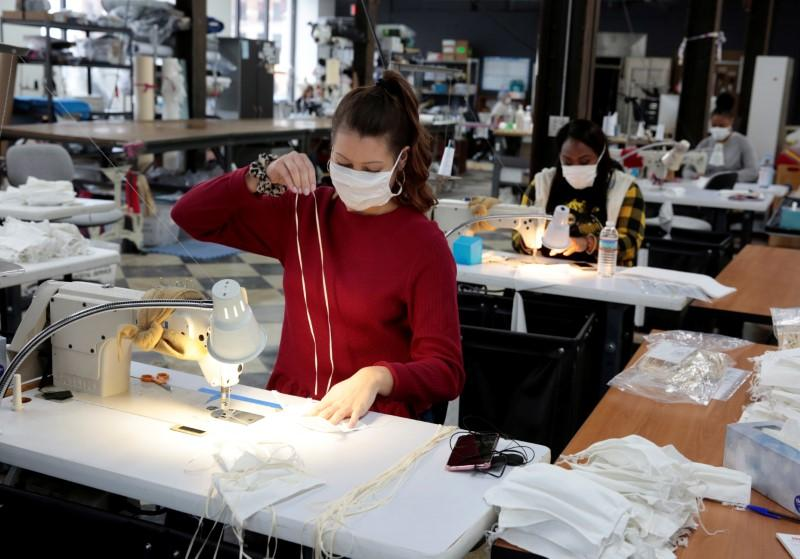 Analiese Zaleski sews hospital masks, as the spread of coronavirus disease (COVID-19) continues, on day one of turning the Detroit Sewn facility into a production facility for hospital masks in Pontiac, Michigan, U.S., March 23, 2020. REUTERS/Rebecca Cook