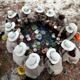 Members of all-female landmines clearance team sit under the shadow of a tree for their lunch on a field in Quang Tri province, Vietnam March 4, 2020. Picture taken March 4, 2020. REUTERS/Kham