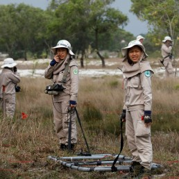 Members of all-female landmines clearance team search for unexploded ordnances on a field in Quang Tri province, Vietnam March 4, 2020. Picture taken March 4, 2020. REUTERS/Kham