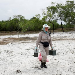 Captain Nguyen Thi Thuy of all-female landmines clearance team carries boxes of detonators to destroy unexploded ordnances found on a field in Quang Tri province, Vietnam March 4, 2020. Picture taken March 4, 2020. REUTERS/Kham