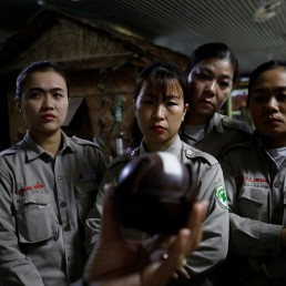 Members of all-female landmines clearance team look at a sample of B-bomb at a bombs and landmines exhibition in Quang Tri province, Vietnam March 4, 2020. Picture taken March 4, 2020. REUTERS/Kham