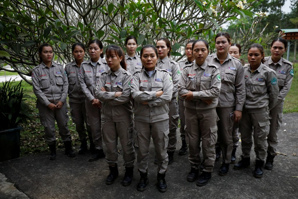 Members of all-female landmines clearance team listen to their captain before their morning work at a bombs and landmines exhibition in Quang Tri province, Vietnam March 4, 2020. Picture taken March 4, 2020. REUTERS/Kham