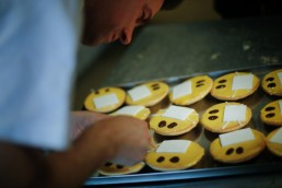 Baker Tim Kortuem produces cakes that look like emojis with protective masks at his bakery, as the spread of the coronavirus disease (COVID-19) continues in Dortmund, Germany, March 26, 2020. REUTERS/Leon Kuegeler
