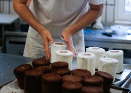 Baker Tim Kortuem produces cakes in the shape of a roll of toilet paper at his bakery, as the spread of the coronavirus disease (COVID-19) continues in Dortmund, Germany, March 26, 2020. REUTERS/Leon Kuegeler