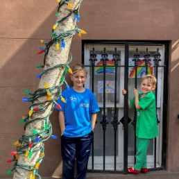 """Whit, 8 and Colton, 6, display pictures they drew in their home """"art class"""" as part of the Quarantine Rainbow Project in Brooklyn, New York, March 18, 2020. Picture taken March 18, 2020. REUTERS/Lauren Young"""