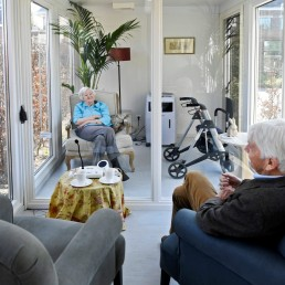 A man visits his wife at a care facility for elderly people with dementia, in a glass house that is made especially against loneliness caused by the visit ban due to the coronavirus disease (COVID-19) outbreak in Wassenaar, Netherlands, April 9, 2020. REUTERS/Piroschka van de Wouw