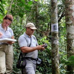 Cristina Tingle and Carlos Valderrama of WebConserva Foundation check a camera trap installed in a field in San Lucas, Colombia February 26, 2020. Picture taken February 26, 2020. REUTERS/Oliver Griffin