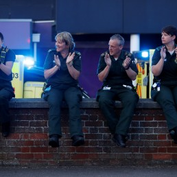 Ambulance crew react outside Luton and Dunstable University Hospital during the Clap for our Carers campaign in support of the NHS, as the spread of the coronavirus disease (COVID-19) continues, in Luton, Britain, April 23, 2020. REUTERS/Matthew Childs