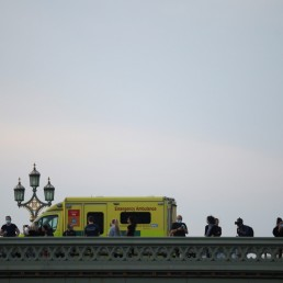 NHS workers are seen on Westminster Bridge during the Clap for our Carers campaign in support of the NHS as the spread of the coronavirus disease (COVID-19) continues, London, Britain, April 23, 2020. REUTERS/Hannah Mckay