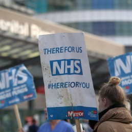 NHS signs are seen outside Queen Elizabeth Hospital during the Clap for our Carers campaign in support of the NHS, as the spread of the coronavirus disease (COVID-19) continues, in Birmingham, Britain, April 23, 2020. REUTERS/Carl Recine
