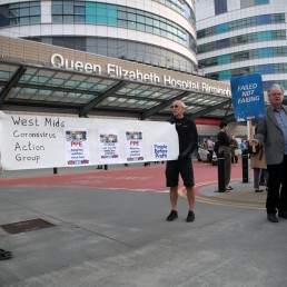 People hold a banner outside Queen Elizabeth Hospital during the Clap for our Carers campaign in support of the NHS, as the spread of the coronavirus disease (COVID-19) continues, in Birmingham, Britain, April 23, 2020. REUTERS/Carl Recine