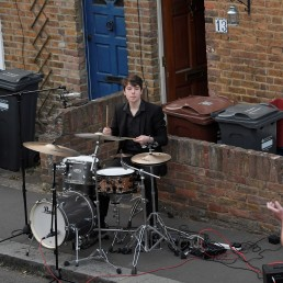 Local resident plays drums outside his house during the Clap for our Carers campaign in support of the NHS, as the spread of the coronavirus disease (COVID-19) continues, in Isleworth, west London, Britain, April 23, 2020. REUTERS/Toby Melville