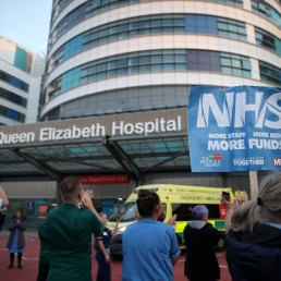 People applaud outside Queen Elizabeth Hospital during the Clap for our Carers campaign in support of the NHS, as the spread of the coronavirus disease (COVID-19) continues, in Birmingham, Britain, April 23, 2020. REUTERS/Carl Recine