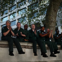 Health workers applaud at St Thomas' Hospital during the Clap for our Carers campaign in support of the NHS as the spread of the coronavirus disease (COVID-19) continues, London, Britain, April 23, 2020. REUTERS/Hannah Mckay
