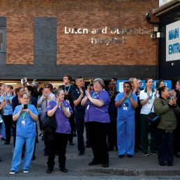 NHS workers react outside Luton and Dunstable University Hospital during the Clap for our Carers campaign in support of the NHS, as the spread of the coronavirus disease (COVID-19) continues, in Luton, Britain, April 23, 2020. REUTERS/Matthew Childs