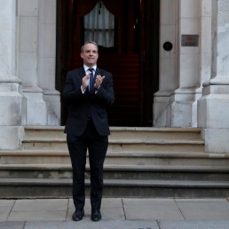 Britain's Foreign Secretary Dominic Raab applauds to show his appreciation for National Health Service (NHS) staff working amid the coronavirus disease (COVID-19) outbreak, during the weekly