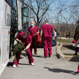 A bus carrying Canadian Armed Forces (CAF) medical personnel arrives at Villa Val des Arbres, a seniors' long-term care centre, to help amid the outbreak of the coronavirus disease (COVID-19), in Montreal, Quebec, Canada April 20, 2020. REUTERS/Christinne Muschi