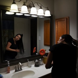 Pregnant nurse Samantha Salinas brushes her hair after getting home from work and showering amid a coronavirus disease (COVID-19) outbreak in San Antonio, Texas, U.S., May 7, 2020. REUTERS/Callaghan O'Hare