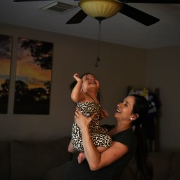 Pregnant nurse Samantha Salinas shares a loving moment with her daughter, Macie, amid a coronavirus disease (COVID-19) outbreak in San Antonio, Texas, U.S., May 6, 2020. REUTERS/Callaghan O'Hare