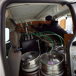 Director of Forest Road Brewing Co Peter Brown checks the beer taps inside the Forest Road Brewing Co pub on wheels vehicle ahead of his delivery round in Hackney, as the coronavirus disease (COVID-19) spread continues in London, Britain, May 12, 2020. REUTERS/Hannah McKay
