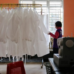 Nur Afia Qistina Zamzuri, a 9-year-old girl inspects a personal protective equipment (PPE) she made for free to medical workers working in local hospitals at her home, amid the coronavirus disease (COVID-19) outbreak, in Kuala Pilah, Malaysia May 5, 2020. REUTERS/Lim Huey Teng