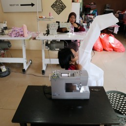 Nur Afia Qistina Zamzuri, a 9-year-old girl sews personal protective equipment (PPE) for free to medical workers working in local hospitals at her home with her mother Hasnah Hud, amid the coronavirus disease (COVID-19) outbreak, in Kuala Pilah, Malaysia May 5, 2020. REUTERS/Lim Huey Teng