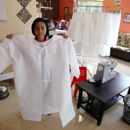 Nur Afia Qistina Zamzuri, a 9-year-old girl poses for a picture holding a personal protective equipment (PPE) she made for free to medical workers working in local hospitals at her home, amid the coronavirus disease (COVID-19) outbreak, in Kuala Pilah, Malaysia May 5, 2020. REUTERS/Lim Huey Teng