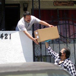 Taxi driver Fredy Gomez, 51, who has not worked for a month, delivers food from the Westin Bonaventure hotel to seniors, as part of California Governor Gavin Newsom's program to use FEMA and local money to produce meals to deliver to at-risk seniors, as the global outbreak of the coronavirus disease (COVID-19) continues, in Los Angeles, California, U.S., May 8, 2020. REUTERS/Lucy Nicholson
