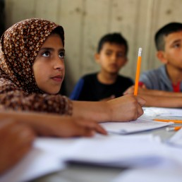 Children attend an Arabic language lesson given by a Palestinian school girl Fajr Hmaid, 13, as schools are shut due to the coronavirus disease (COVID-19) restrictions, at Hmaid's family house in Gaza, May 19, 2020. REUTERS/Mohammed Salem