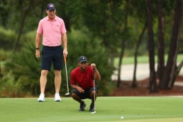 May 24, 2020; Hobe Sound, FL, USA; Tiger Woods and former NFL player Peyton Manning read a putt on the sixth green during The Match: Champions for Charity golf round at the Medalist Golf Club. Mandatory Credit: Handout Photo by Getty Images for The Match via USA TODAY Sports
