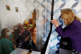 Maria das Merces speaks with her father Adriano Borges through a glass window to prevent infection at an elderly residence as the spread of the coronavirus disease (COVID-19) continues, in Montijo, Portugal May 12, 2020. REUTERS/Rafael Marchante