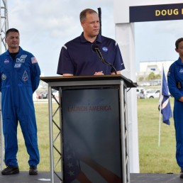 Astronauts Kjell Lindgren (L) and Nicole Mann listen as NASA administrator Jim Bridenstine talks to the media during a prelaunch briefing before the launch of the SpaceX Crew Dragon spacecraft on a Falcon 9 booster rocket from Pad39A at the Kennedy Space Center in Cape Canaveral, Florida, U.S., May 29, 2020. REUTERS/Steve Nesius