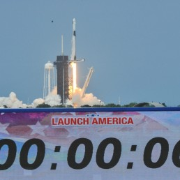 A count down clock is shown as SpaceX Falcon 9 rocket and Crew Dragon spacecraft carrying NASA astronauts Douglas Hurley and Robert Behnken lifts off during NASA's SpaceX Demo-2 mission to the International Space Station from NASA's Kennedy Space Center in Cape Canaveral, Florida, U.S. May 30, 2020. REUTERS/Steve Nesius