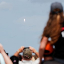 People view the launch of a SpaceX Falcon 9 rocket and Crew Dragon spacecraft carrying NASA's astronauts Douglas Hurley and Robert Behnken during NASA's SpaceX Demo-2 mission to the International Space Station from NASA's Kennedy Space Center, in Cape Canaveral, Florida, U.S. May 30, 2020. REUTERS/Scott Audette