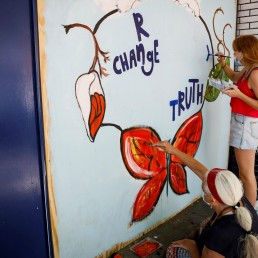 Artist Eileen Duster and her daughter Ave paint a mural on a boarded-up restaurant as part of neighborhood project in the Bowery neighborhood of Manhattan in New York City, New York, U.S., June 17, 2020. Picture taken June 17, 2020. REUTERS/Brendan McDermid
