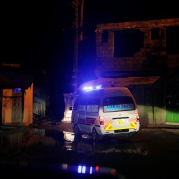 An ambulance drives to a pregnant woman during the coronavirus night curfew in Nairobi, Kenya June 19, 2020. Picture taken June 19, 2020. REUTERS/Baz Ratner