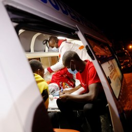Medics examine a pregnant woman in an ambulance during the coronavirus night curfew in Nairobi, Kenya June 19, 2020. Picture taken June 19, 2020. REUTERS/Baz Ratner