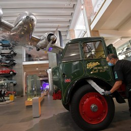 An employee cleans exhibits ahead of the reopening of the Science Museum, after lockdown restrictions were eased following the outbreak of the coronavirus disease (COVID-19), London, Britain, August 10, 2020. REUTERS/Toby Melville