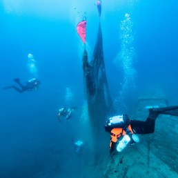 Inflated lifting bags are seen attached to a ghost fishing net as volunteer divers of the environmental group Ghost Diving swim near the WWII wreck of the HMS Perseus, off the island of Kefalonia, Greece, July 26, 2020. Cor Kuyvenhoven/Ghost Diving/Handout via REUTERS