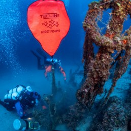 Inflated lifting bags are seen attached to a ghost fishing net as volunteer divers of the environmental group Ghost Diving work near the WWII wreck of the HMS Perseus, off the island of Kefalonia, Greece, July 23, 2020. Giorgos Kolikis/Ghost Diving/Handout via REUTERS