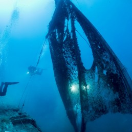 Volunteer divers of the environmental group Ghost Diving work next to ghost nets, near the WWII wreck of the HMS Perseus, off the island of Kefalonia, Greece, July 26, 2020. Cor Kuyvenhoven/Ghost Diving/Handout via REUTERS