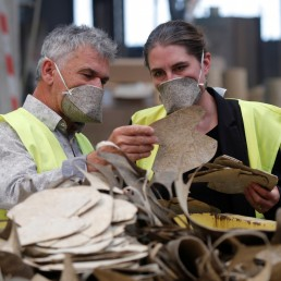 Frederic Roure, founding President of French company Geochanvre, and his marketing officer Sandrine Boudier check pieces of fiber canvas made from hemp to make compostable face masks at French company Geochanvre in Lezinnes, France, September 10, 2020. REUTERS/Charles Platiau